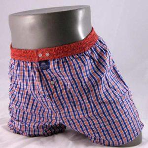 paspop met wijde, geruite boxershort in oranje en blauw